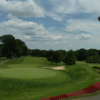 A view of a green flanked by sand traps at Springfield Golf & Country Club