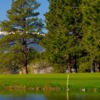 A view over the water of a hole at The Country Club at Woodmoor