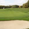 A view of the 15th green protected by bunkers at Norwich Golf Club