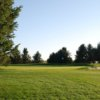 A view of a hole protected by a bunker at Raymond Golf Course