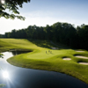 A view of the 18th green surrounded by tricky bunkers at Cedar River from Shanty Creek