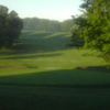A view of a green flanked by sand traps at Waveland Golf Course