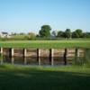 A view over the water of hole #12 at River Valley Golf Course