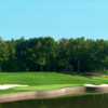 A view over the water of a green flanked by bunkers at Medinah Country Club