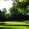 A view of a green with a bunker on the right side at Beaverdale Golf Club
