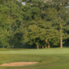 A view of a green protected by sand traps at Ravinia Green Country Club