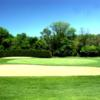 A view of a hole surrounded by bunkers at Libertyville Golf Course