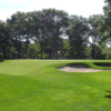 A view of a green protected by bunkers at Pocasset Golf Club