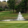 A view of a hole guarded by a water fountain at Indian Pond Country Club