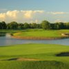 A view of a green surrounded by water and tricky sand traps at Edinburgh USA Golf Course