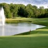 A view of a green with water coming into play at Milwood Golf & Racquet Club