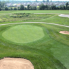 A view of a green protected by sand traps at Deer Lake Golf Club