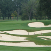 A view of a hole protected by a collection of tricky bunkers at Meadowbrook Country Club