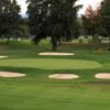 A view of the 14th green protected by bunkers at Shaker Ridge Country Club