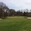 A view of the 10th green flanked by bunkers at Shennecossett Golf Club