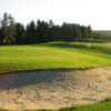 A view of a hole protected by a bunker at Winding Brook Country Club
