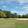 A view of a green protected by a collection of bunkers at Hillcrest Golf Course