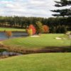 A view of a green protected by bunkers at Pequabuck Golf Club