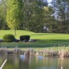 View of a green and a pond at Golden Sands Golf Course