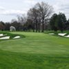A view of a green flanked by bunkers at West from Upper Montclair Country Club