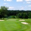 A view of the 17th green protected by sand traps at Crestmont Country Club