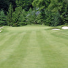 A view of the 16th green flanked by sand traps at Ardsley Country Club