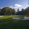 A view of a hole guarded by tricky bunkers at Glenwood Country Club