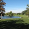 A view over the water of a green at Spring Valley Country Club