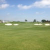 A view of a green protected by two pairs of bunkers on each side at WestRidge Golf Course
