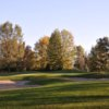 A view of a green protected by sand traps at Currie Golf Course