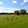 A sunny day view of the practice area at Keith Hills Golf Club