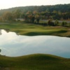 A view of a green with water coming into play at Pine Grove Country Club