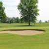 A view of a hole guarded by a bunker at Raintree Country Club
