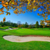 A view of a green surrounded by bunkers at Fantasy Valley Golf Course