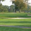A view of a green surrounded by sand traps at Riverton Country Club
