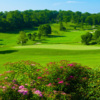 A sunny day view of a hole at Huntingdon Valley Country Club