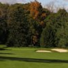A view of a green protected by sand traps at Burlington Country Club