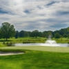A view of a green with water coming into play at Whitford Country Club