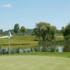 A view of a green with water coming into play at Jericho National Golf Club