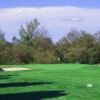 A view of a green protected by sand traps at Green Valley Country Club