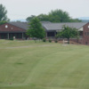 A view from a tee with the clubhouse in the distance at Gallatin Country Club