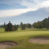A view of the 9th green protected by bunkers at Saw-Whet Golf Club
