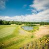 A view of a green with water coming into play at White Horse Golf Club
