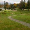 A view of a green protected by sand traps at Greene County Country Club