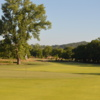 View of a green and fairway at The Grove