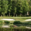 A view of a hole protected by tricky bunkers at Olde Sycamore Golf Plantation