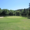 A view of the 10th green with water in background at Oconee Country Club