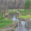 A view of the 16th green with water coming into play at Wolf Run Golf Club