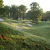 A view of a green protected by tricky bunkers at Wolf Run Golf Club