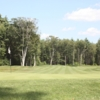 A view of a hole and a fairway at Harmon Golf & Fitness Club